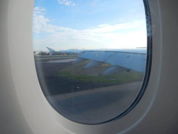 Airplane windown with wing