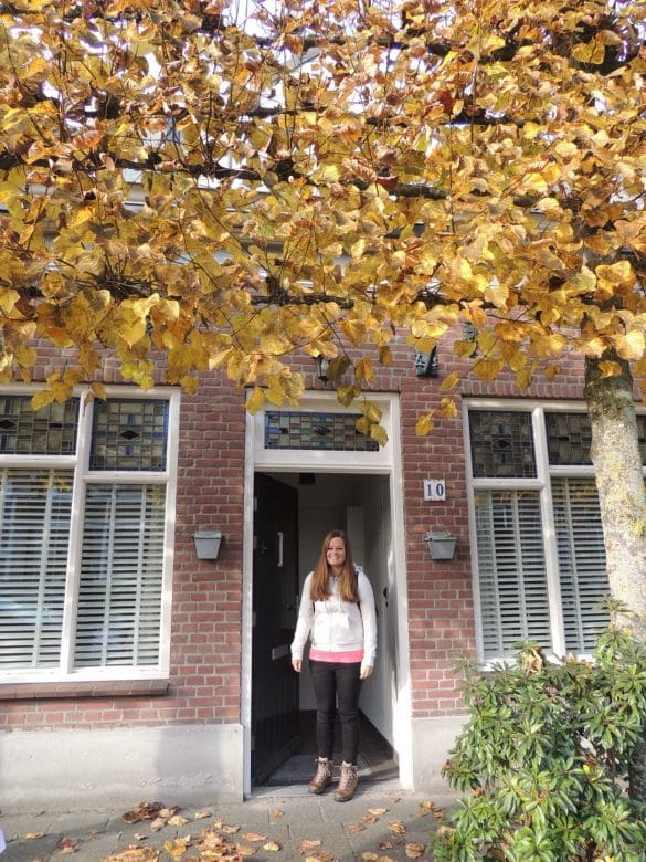 Manon in front of her home
