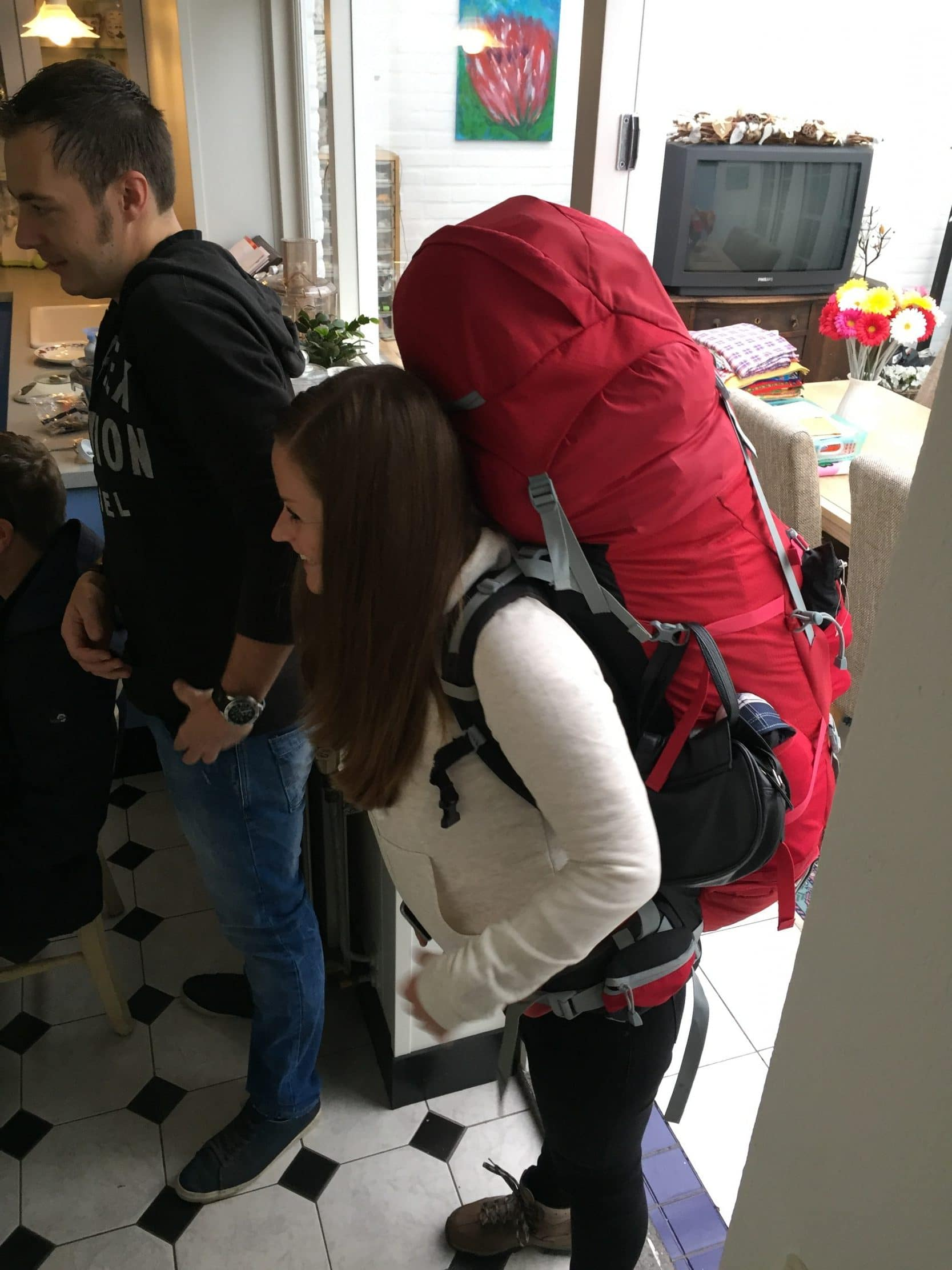 Manon with backpack at home
