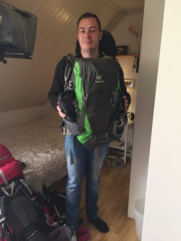 Bram with backpacks at home