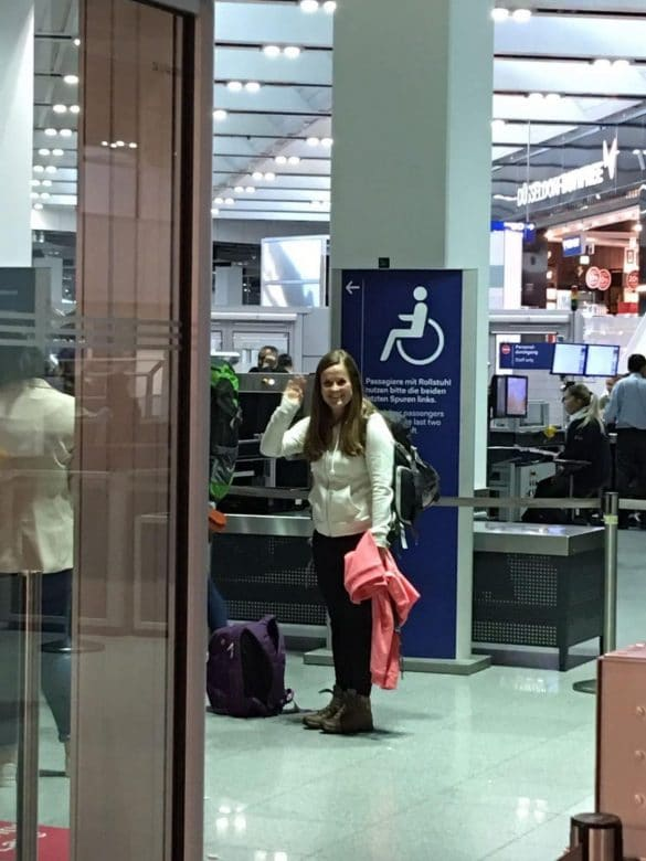 Manon waving goodbye at Dubai International Airport