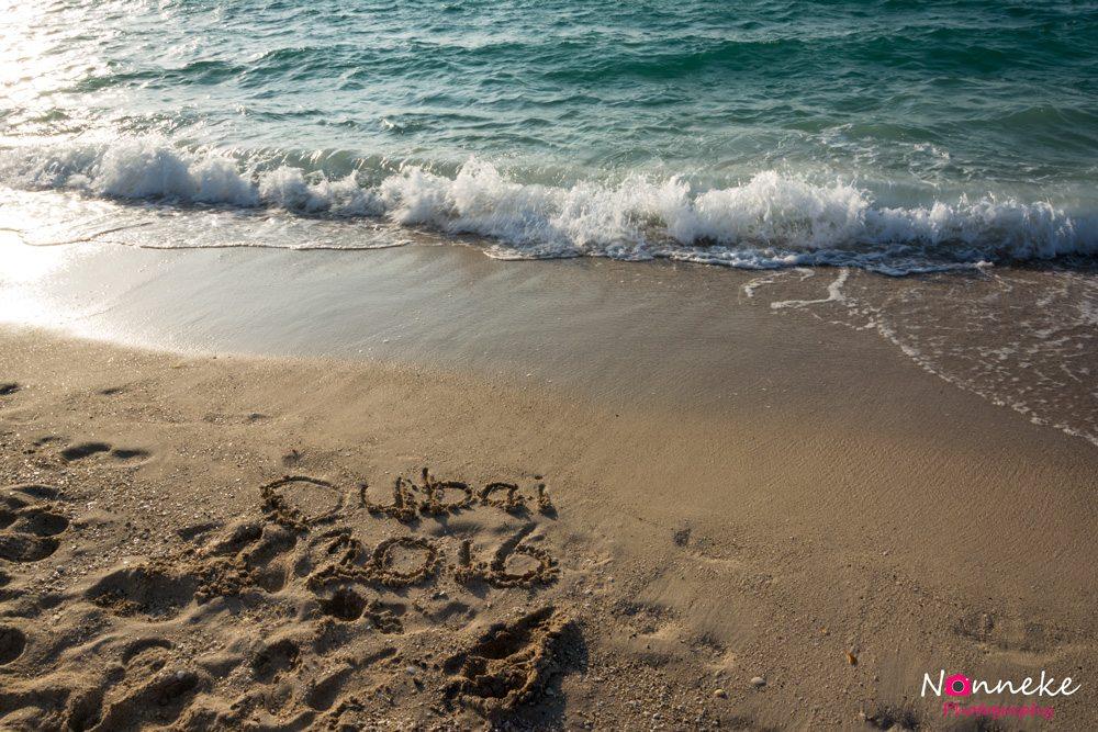 Dubai 2016 written in the sand of Dubai Beach
