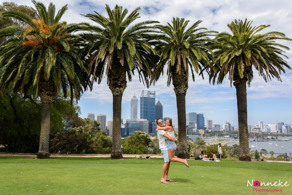 Bram lifting up Manon in Kings Park with the skyline of Perth in the back