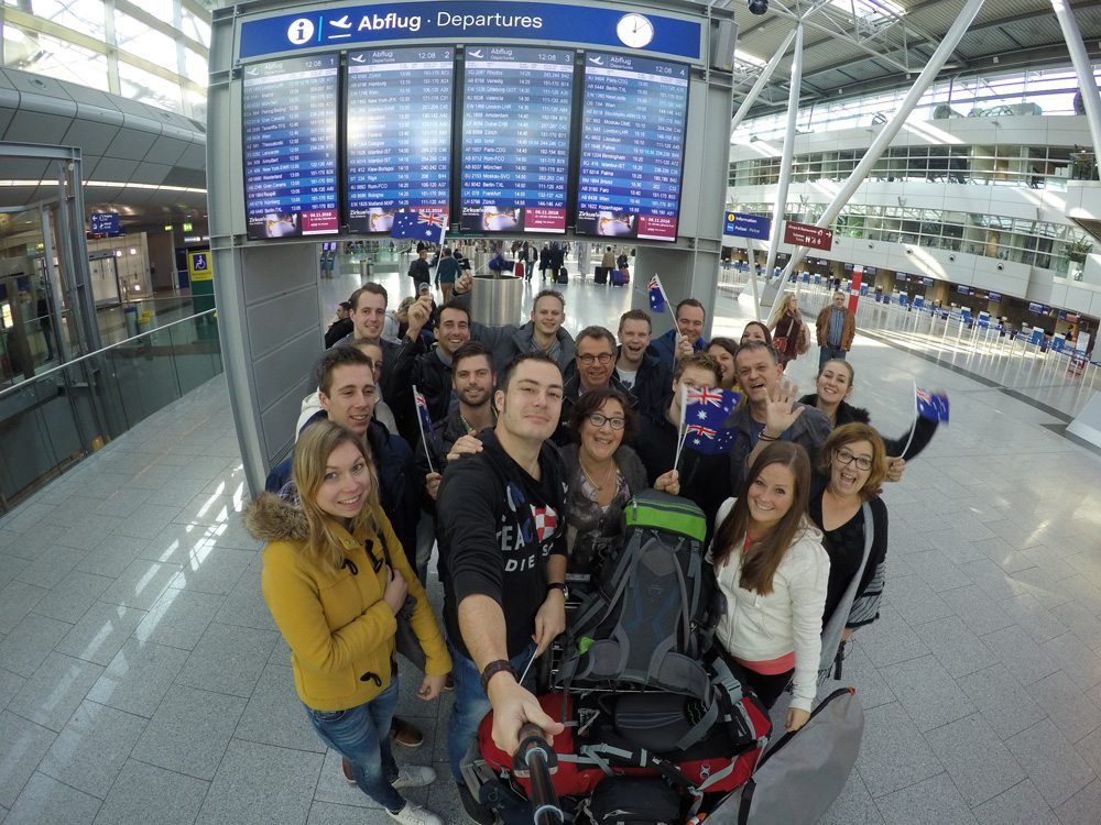 Group selfie with friends and family at the airport