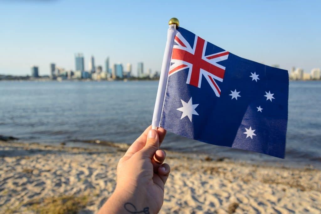 The Australian flag in front of the skyline