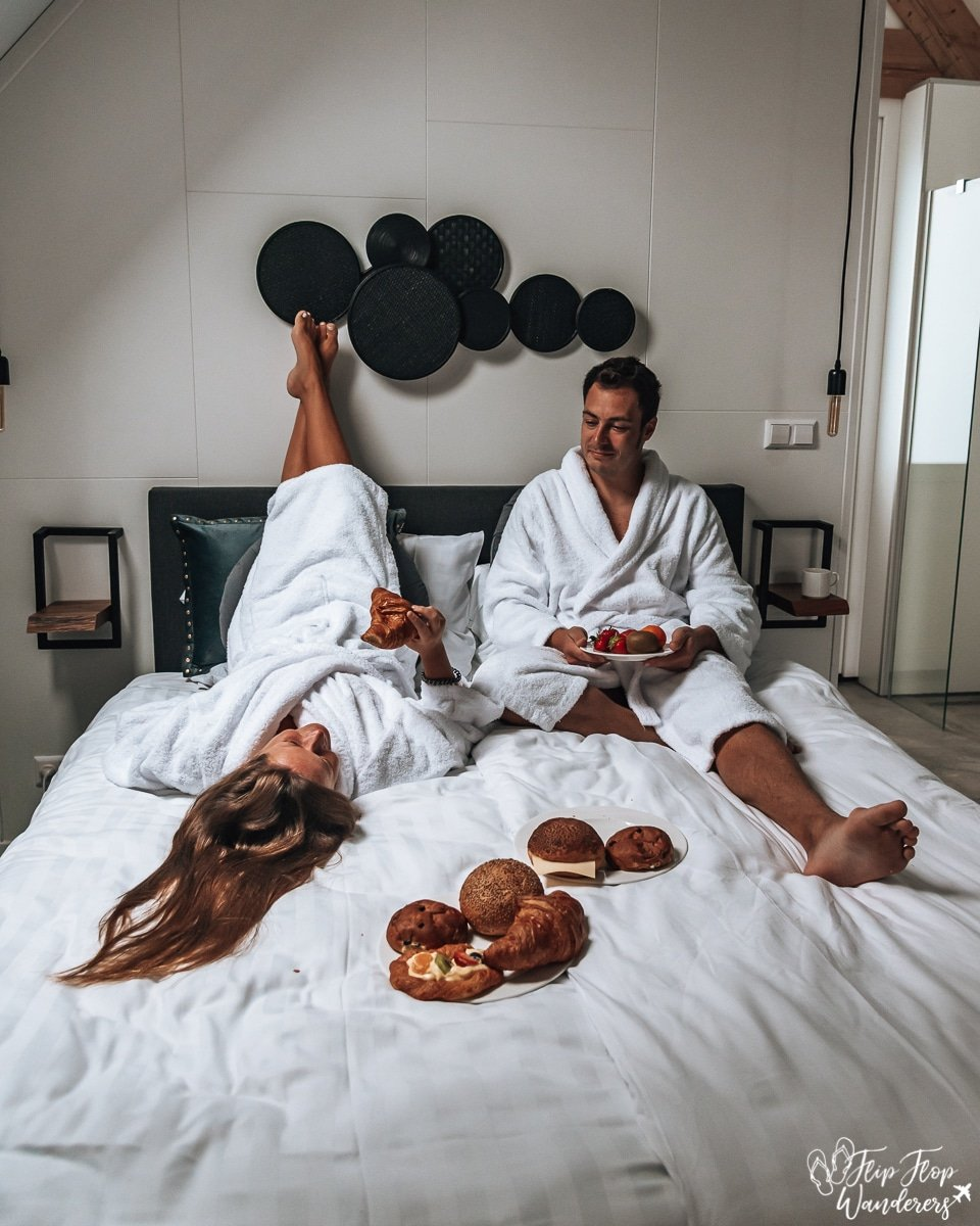 Bram & Manon having breakfast in bed wearing bathrobes