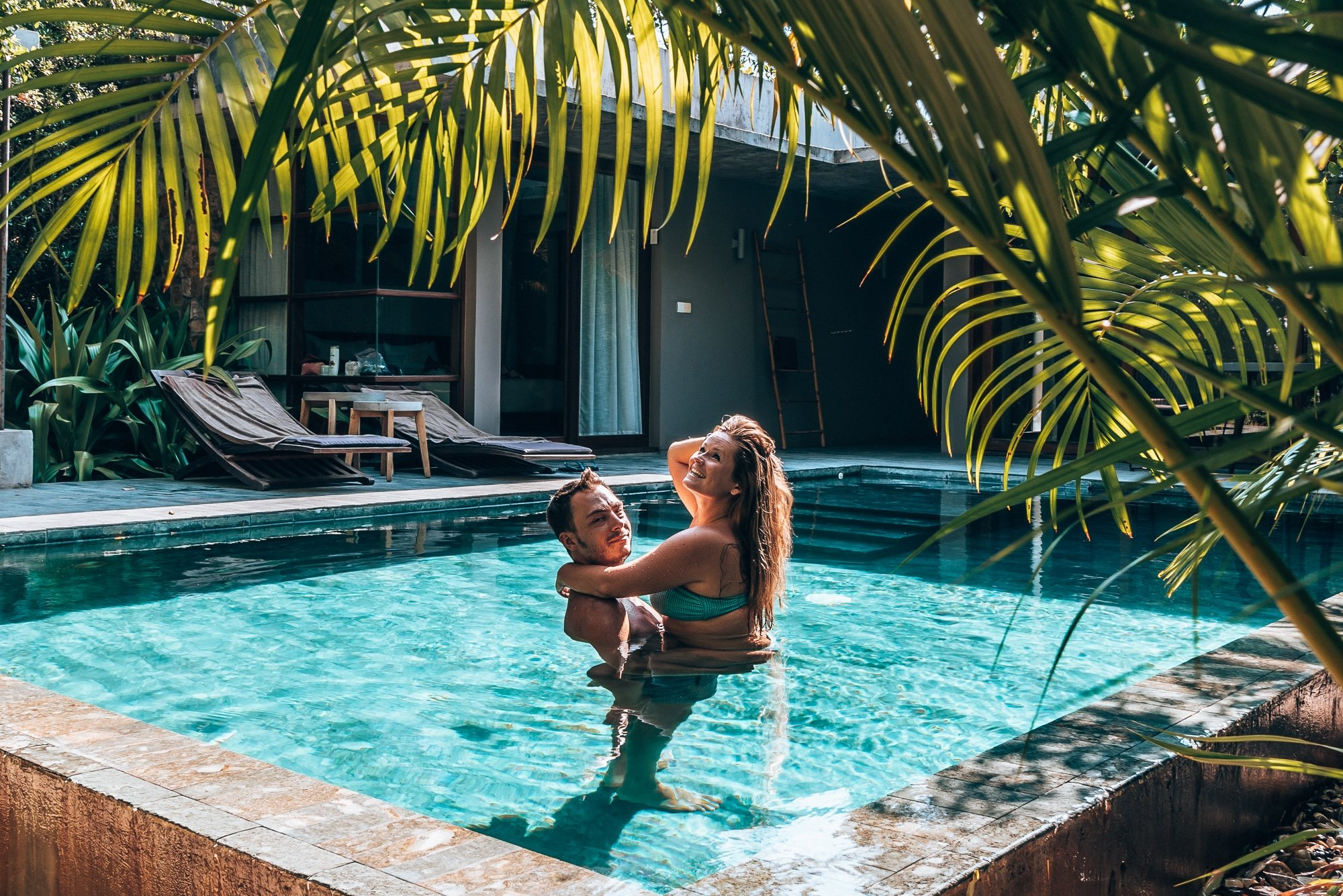 Bram and Manon in a swimming pool at Templation hotel in Siem Reap, Cambodia